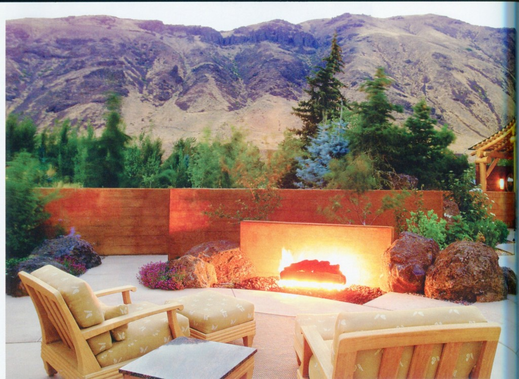 Not sure that we like the ground outside firepit (fireplace might be better), but we do like the low wall that frames the outside view.